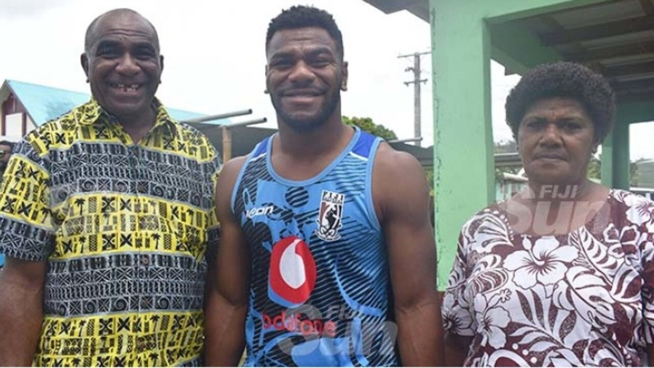 Sivo with his parents Joeli and Mere Nawalu on Christmas Day. Picture: Fiji Sun/Waisea Nasokia