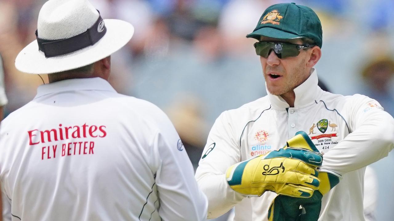 Tim Paine of Australia speaks with umpire Marais Erasmus.