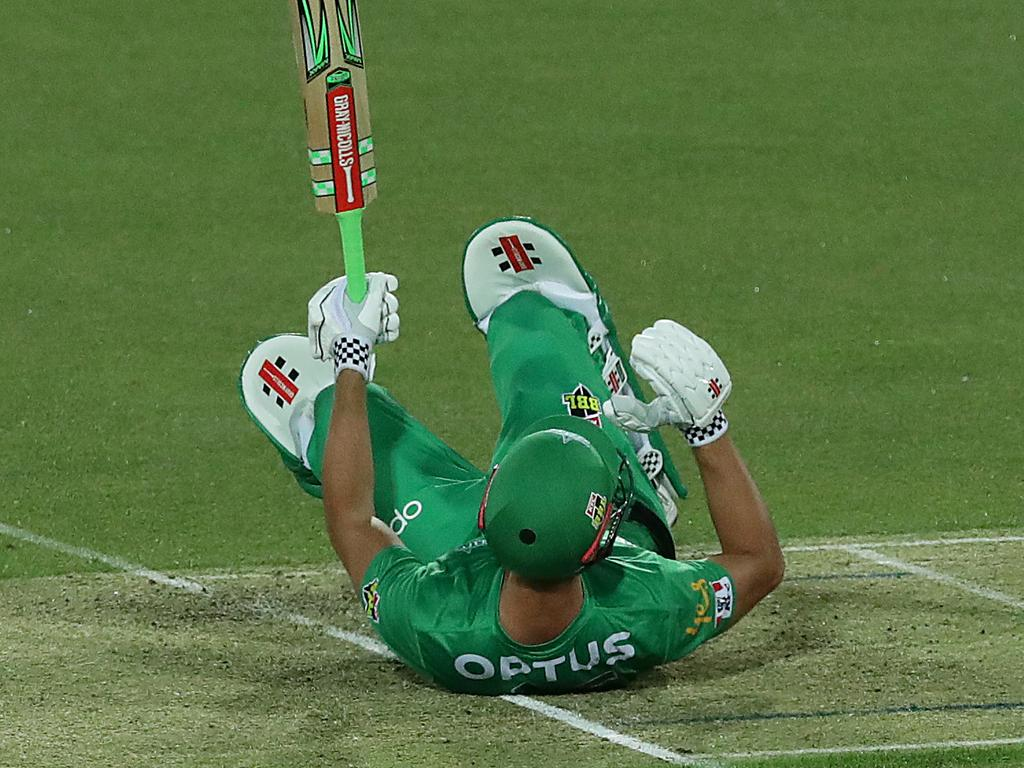 A stunned Stoinis falls back on to the wicket after the frightening strike.