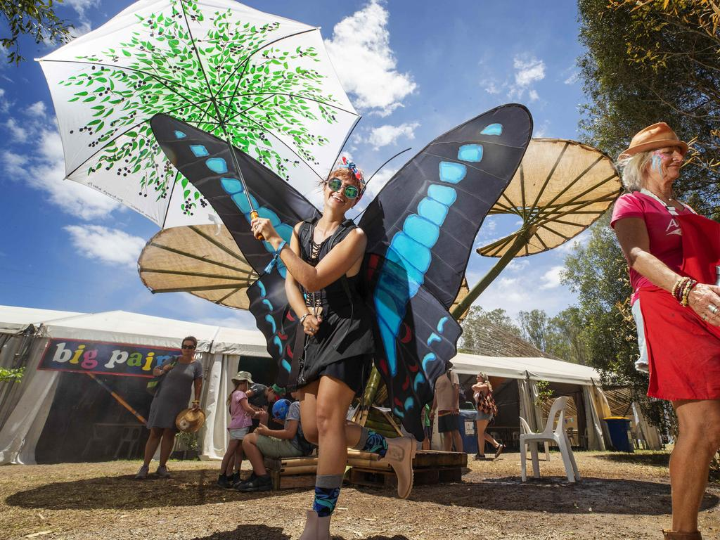 Blue triangle butterfly Rebecca Sheehan under the spray tent at Woodford Folk Festival. Picture: Lachie Millard
