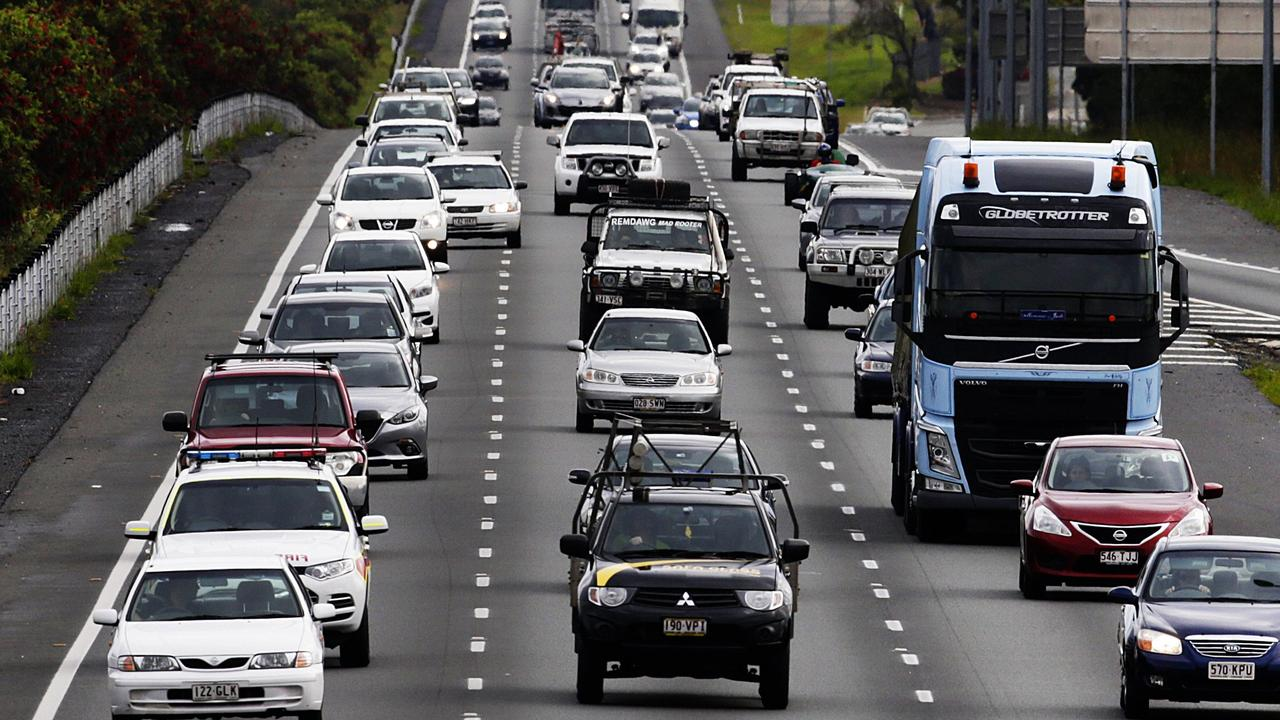 The Bruce Highway and M1 are both gridlocked in 20km of traffic hell as holiday-makers head to the beaches. Motorists are warned to expect long delays