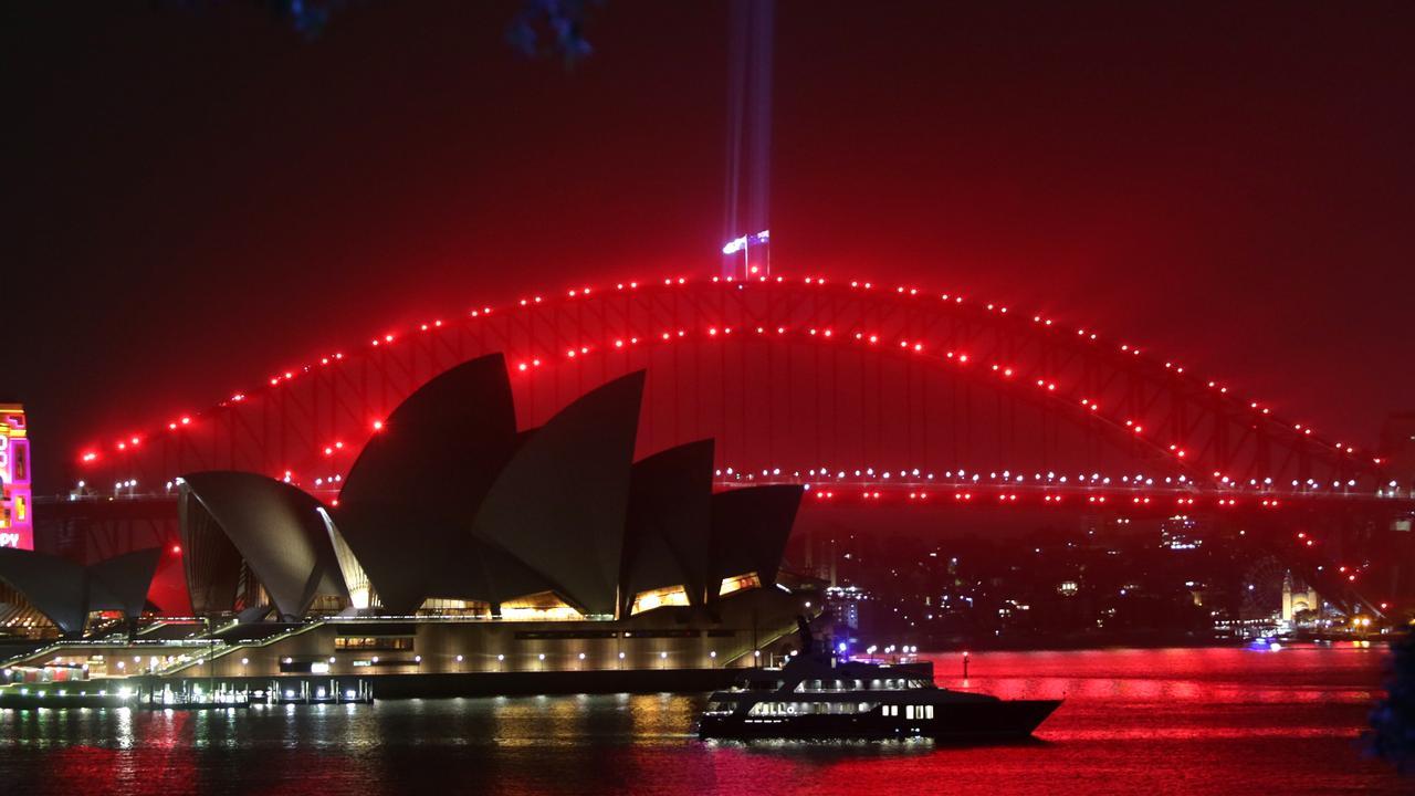 Technicians testing the lighting on the Sydney Harbour Bridge overnight. Picture: Bill Hearne