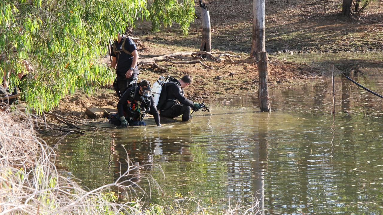 Police divers search a lake on Palmerville Station during the 2012 investigation into the disappearance of Mareeba man Bruce Schuler, 48.