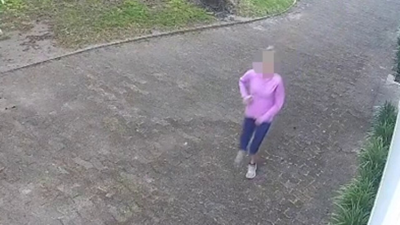 Her bright pink jumper should have been a giveaway, but after she was caught pooing in public, this jogger's identity remains a mystery.