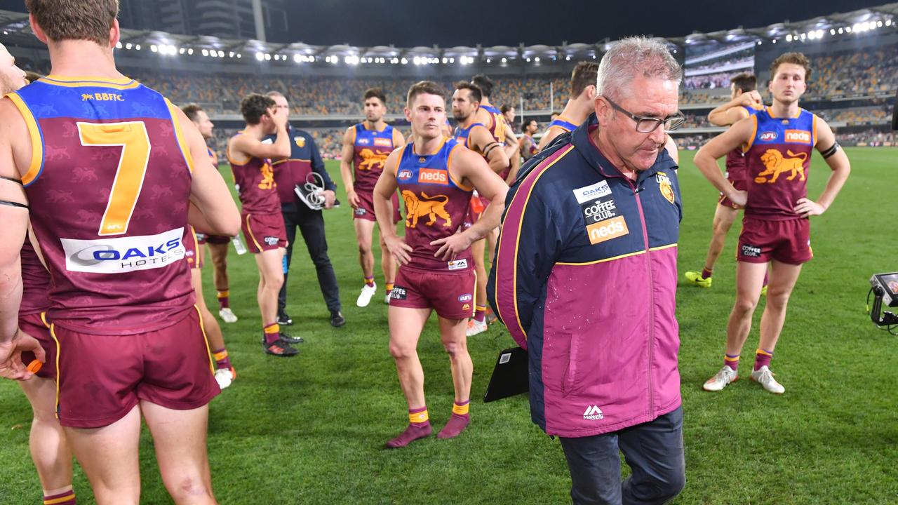 Dejected Brisbane players and coach Chris Fagan after their semi-final loss to GWS. Picture: AAP
