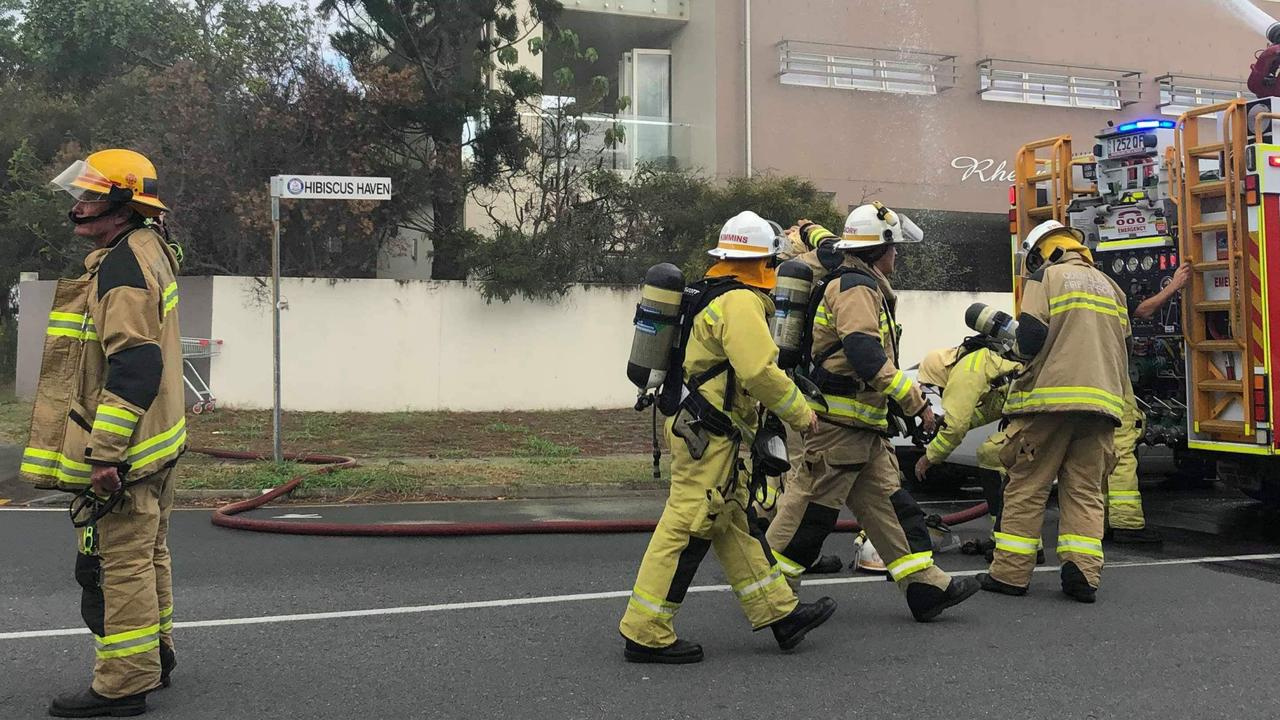 Firefighters outside the Gold Coast unit complex where Sgt Dave Raymond rescued a dog.