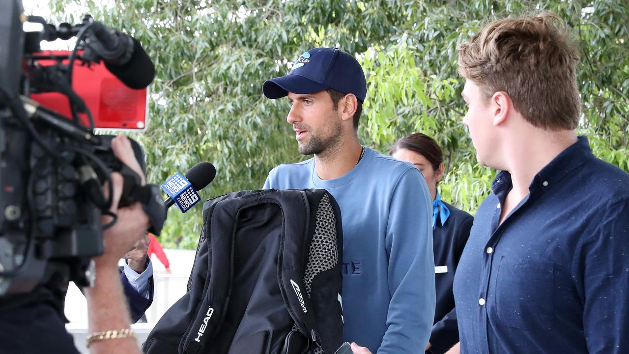 Tennis star Novak Djokovic arrives at Brisbane International Airport for the ATP Cup. Photographer: Liam Kidston.