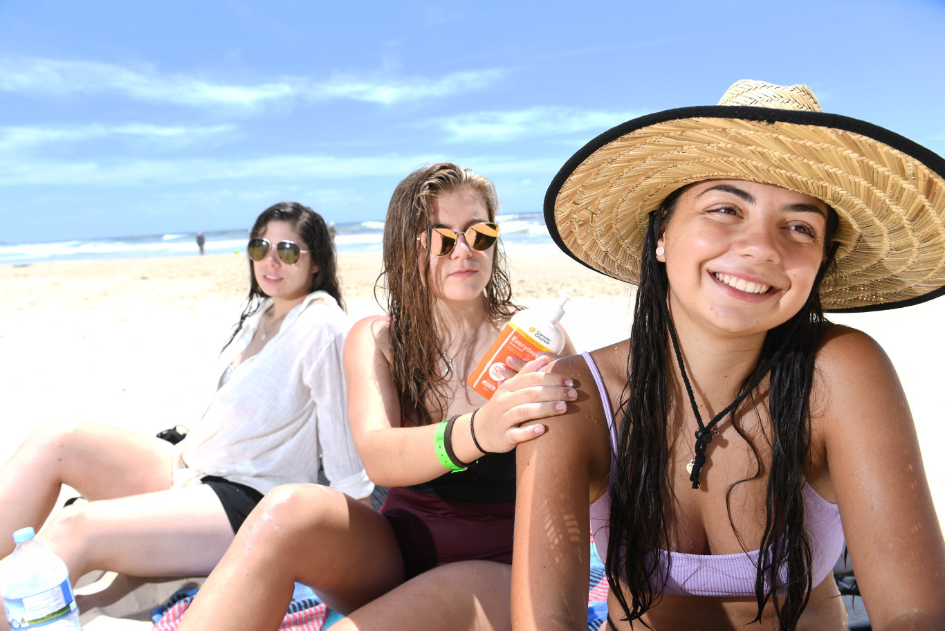 Jasmine Jennings, of Sydney, Josie Hall, of Canberra, and Jennifer Gerner, of Germany, escape the heat at Seven Mile Beach as temperatures soar on the Northern Rivers.