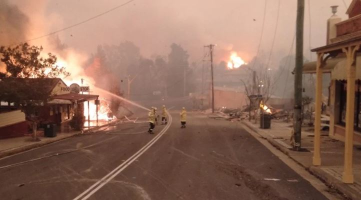 Buildings have been burnt down after a fire tore through the centre of Cobargo on Tuesday morning. Credit: Neil Crawley