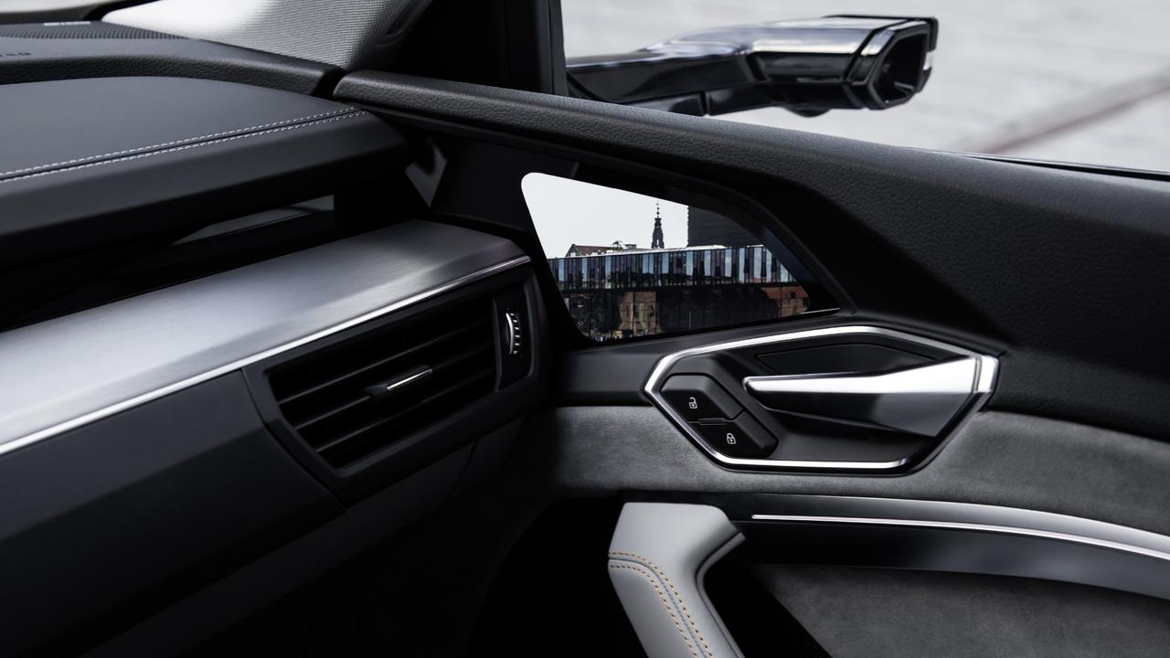 Audi's e-tron combines high-definition cameras with digital screens mounted near its doorhandles.
