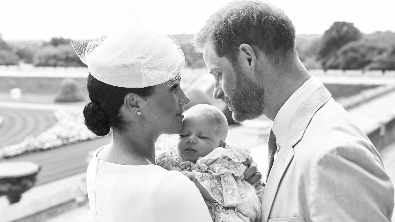 In this official christening photograph, the Duke and Duchess of Sussex pose with their son, Archie Mountbatten-Windsor.