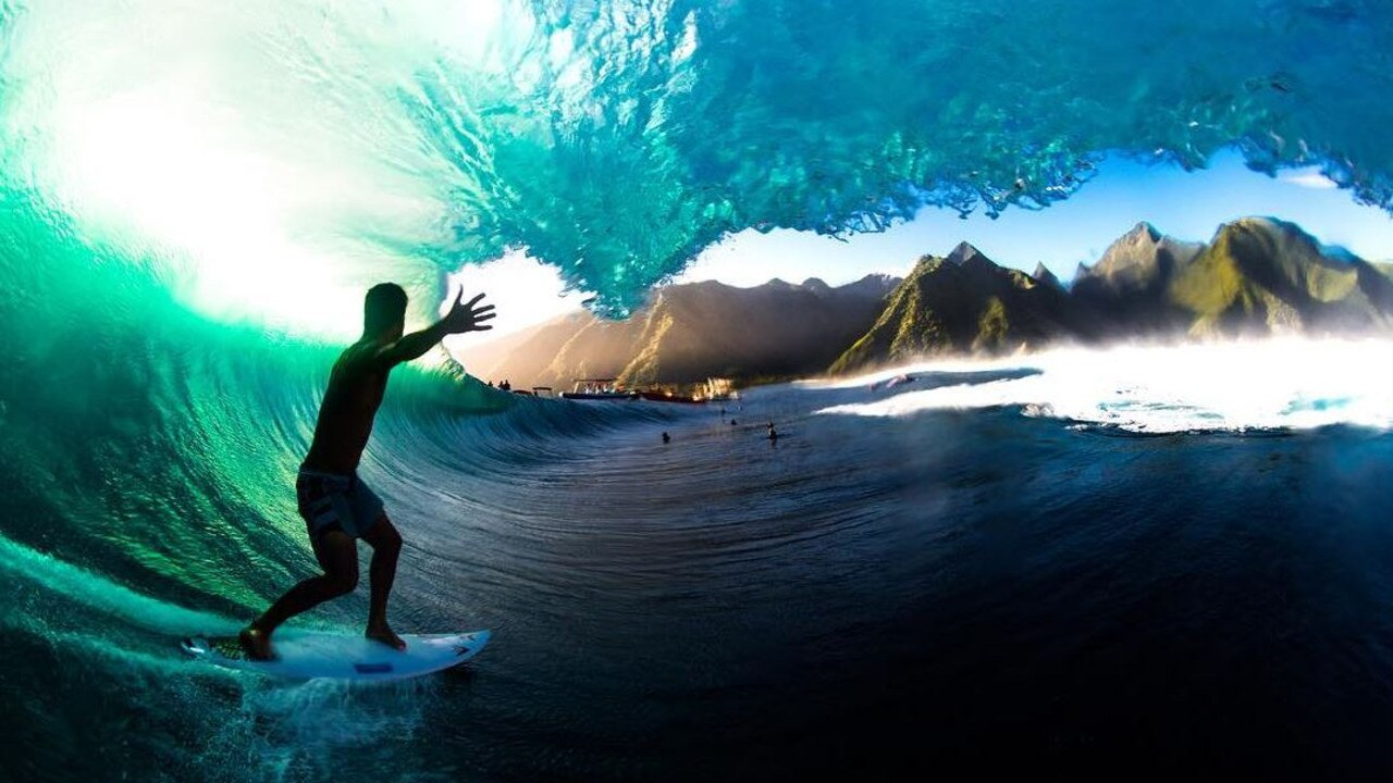 Michel Bourez in a picture perfect tube on Teahupo'o. The photographer would have taken a heavy wipe-out. Picture: Leroy Bellet