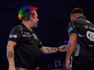 Handshake furore rocks darts final