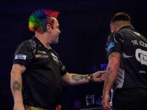 Handshake furore rocks darts final