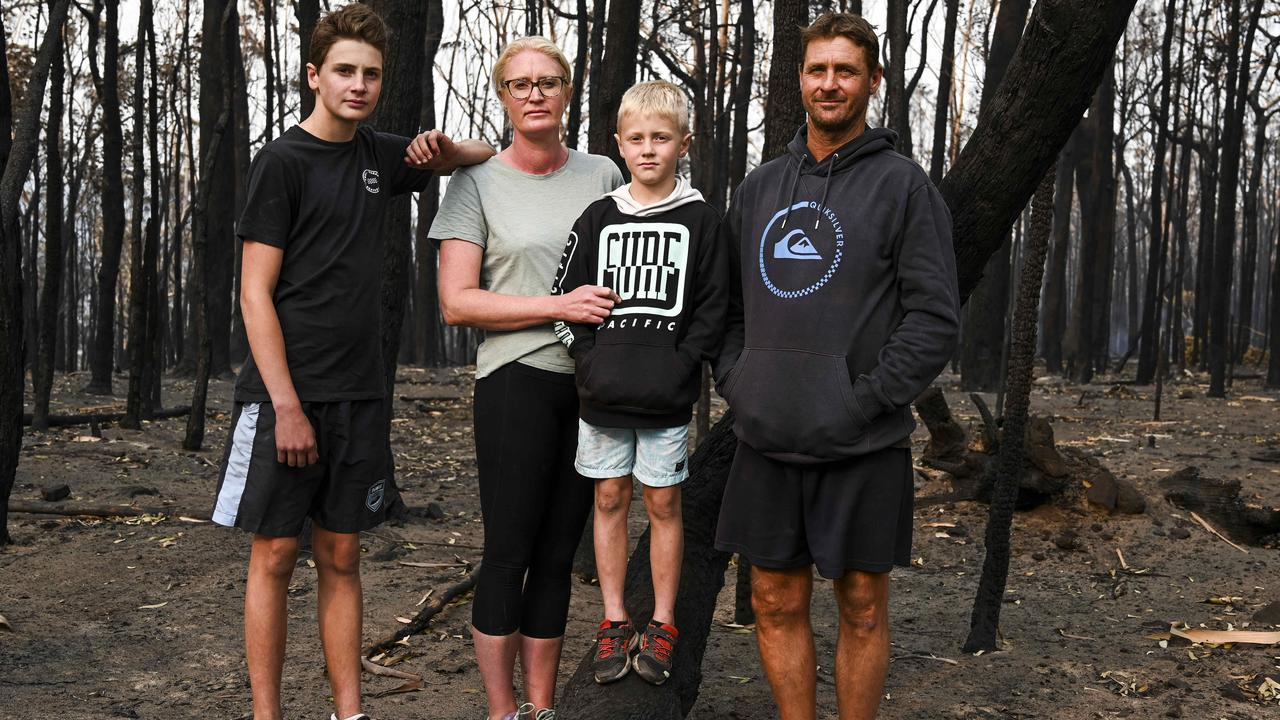 Conjola residents Nikki and Chris Morris sent their sons Taj and Alex to the water while they battled to save their family home. Picture: Darren leigh Roberts