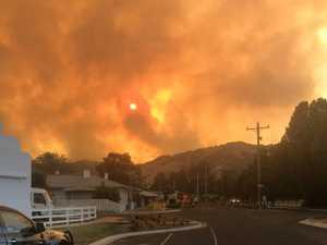 Fatal Green Valley fire spreads across border