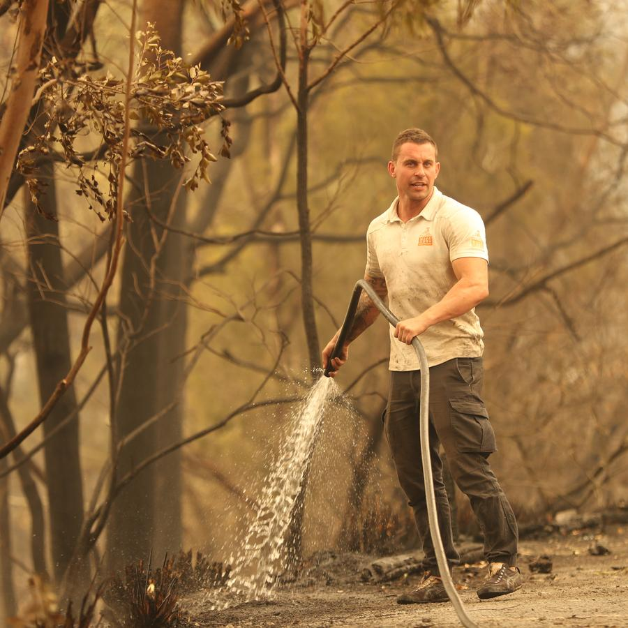 Mogo Zoo director Chad Staples puts out a spot fire at the zoo. Picture: John Grainger