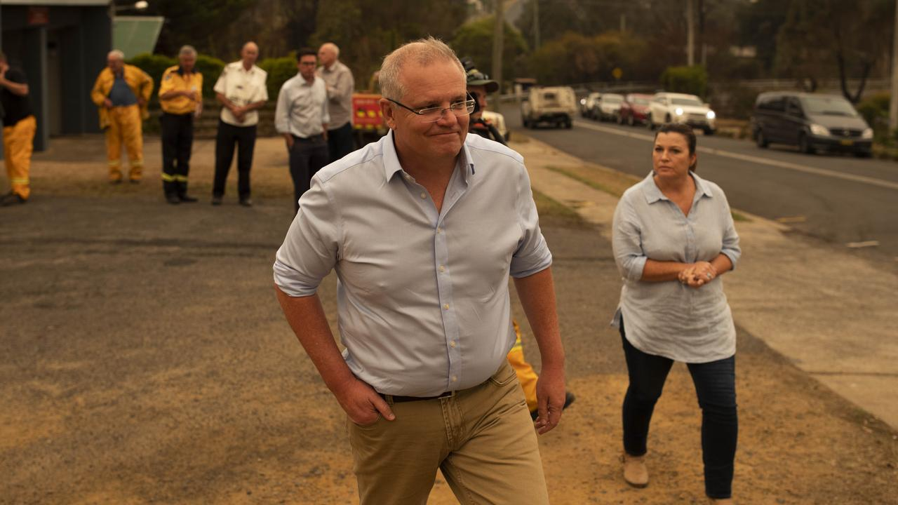 Furious locals in the bushfire-hit town of Cobargo, where two men died and the main street razed, have taken aim at the PM as he visited the area.