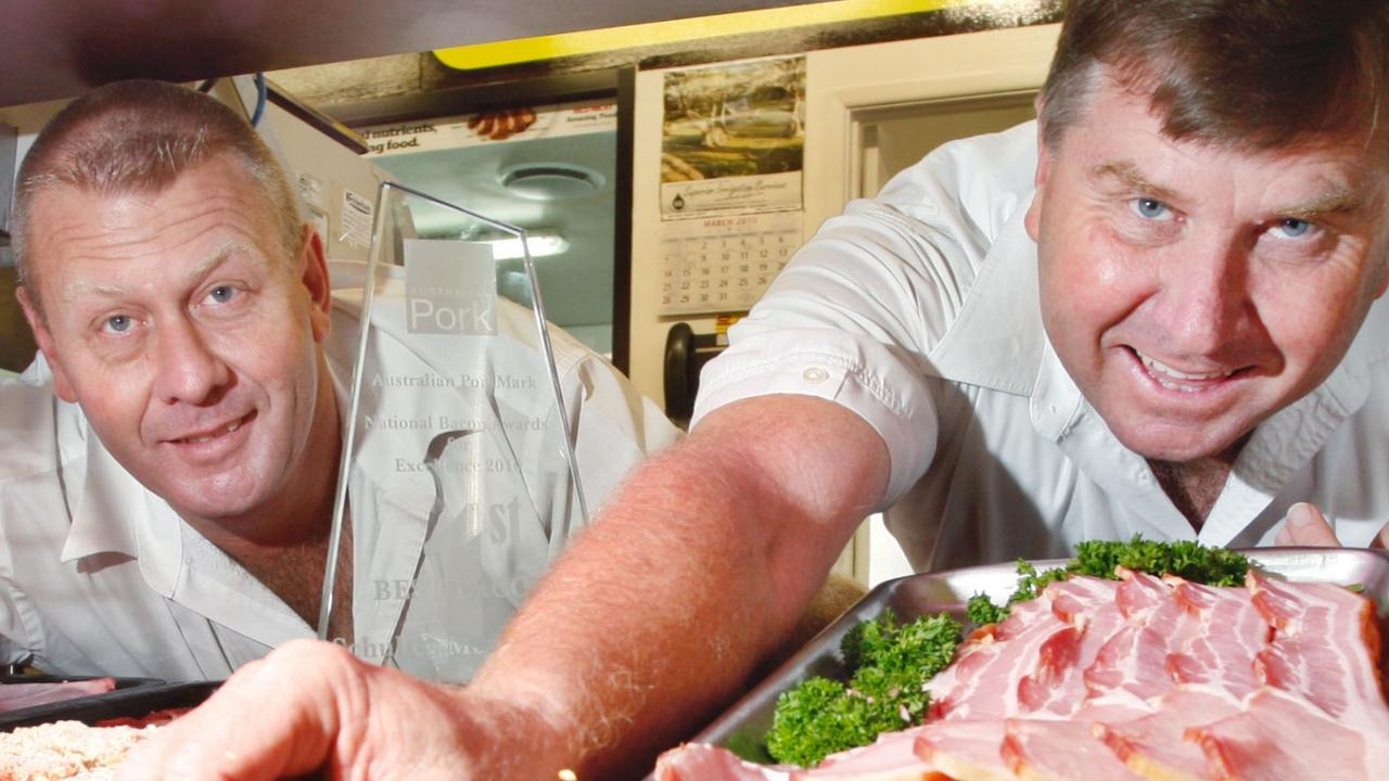 Two brothers who inherited their father's butchery empire have fallen out over how to split their business, with claims one threatened to shoot the other.