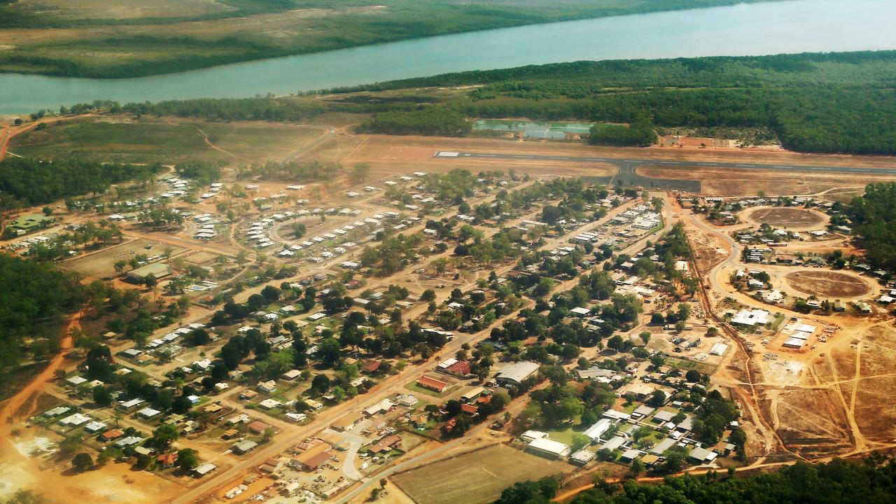 Two teenage males have been charged with murder over the stabbing death of a man in Aurukun amid riots which have reportedly damaged several buildings.