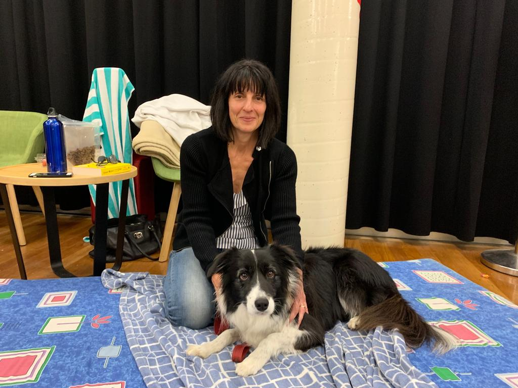 Lesa Spencer with dog Sonny at the Noosa Junction evacuation centre during the forced evacuation in the face of fires at Peregian Beach.