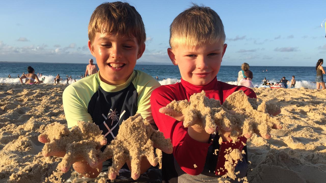 HAPPY NEW YEAR: Lucca Herbert, 11 from Sydney and Samuel Trompf, 8 from Wangaratta, Victoria enjoy January 1 playing in the sand at Noosa Main Beach. Photo: Caitlin Zerafa