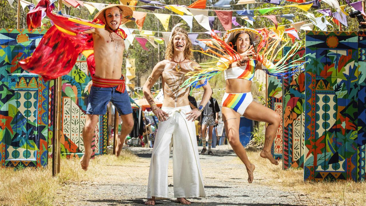 Hamish Doncaster from Byron Bay, Lucas Vignaud from France and Nica Cor from Brazil, get into the spirit at the Woodford Folk Festival. Photo Lachie Millard
