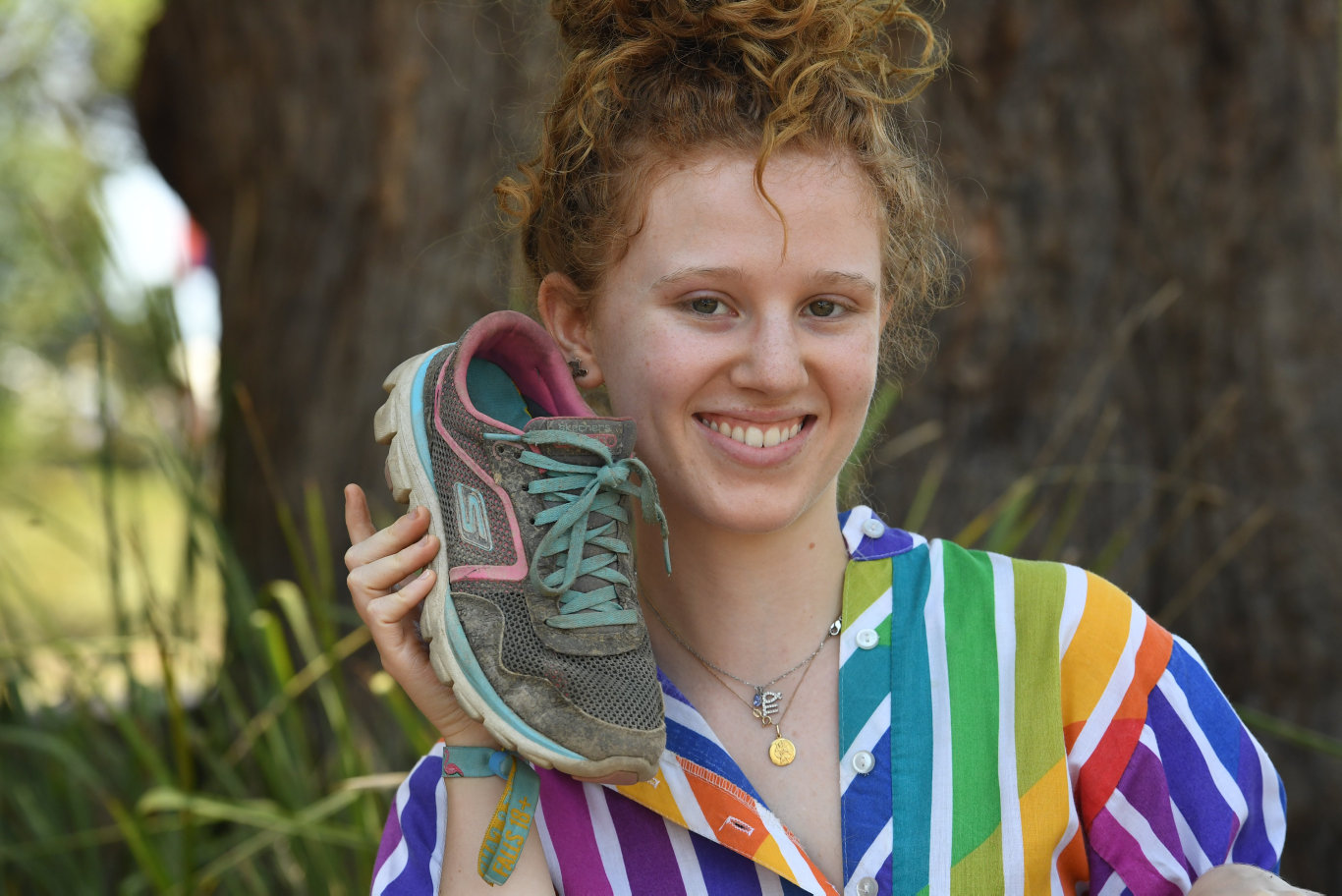 Kelly Corbett, of Brisbane, with her joggers at Falls Festival in Byron Bay.