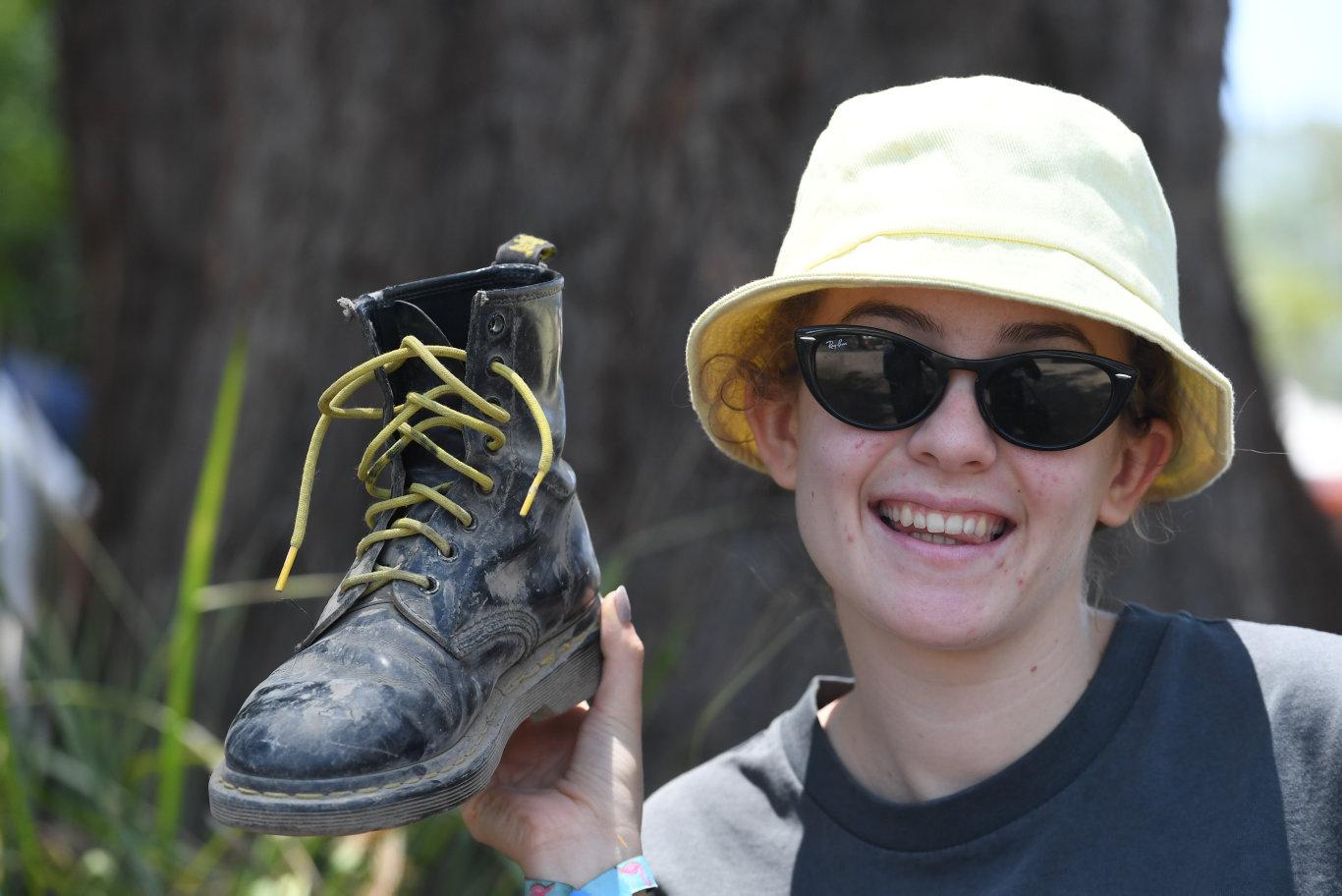 Clara Denham, of Brisbane, with her docs at Falls Festival in Byron Bay.