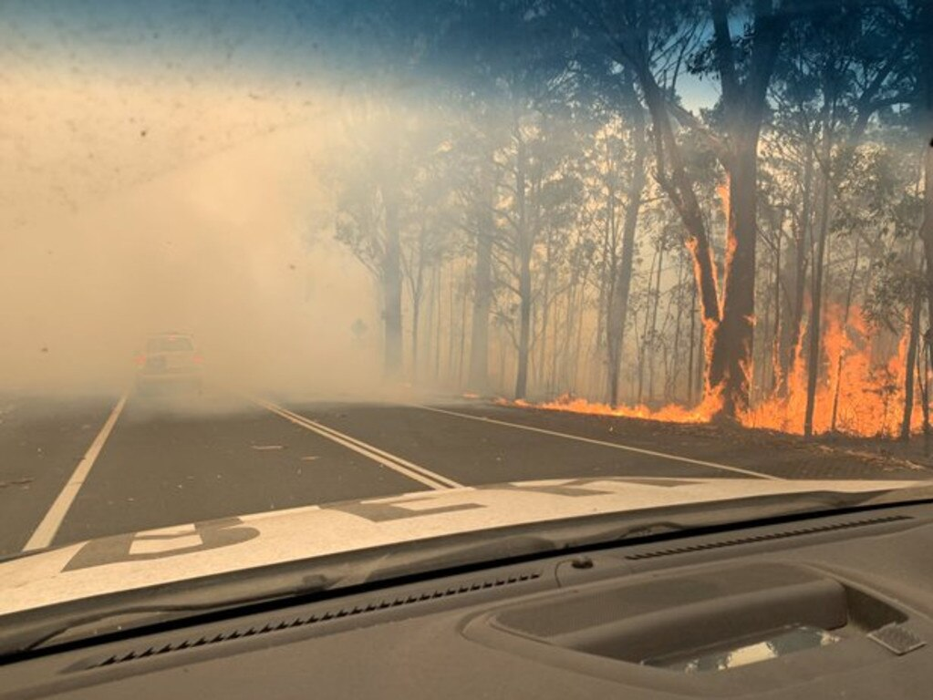 Fires burning on the side of the road at the Sussex Inlet turn-off near Jervis Bay.
