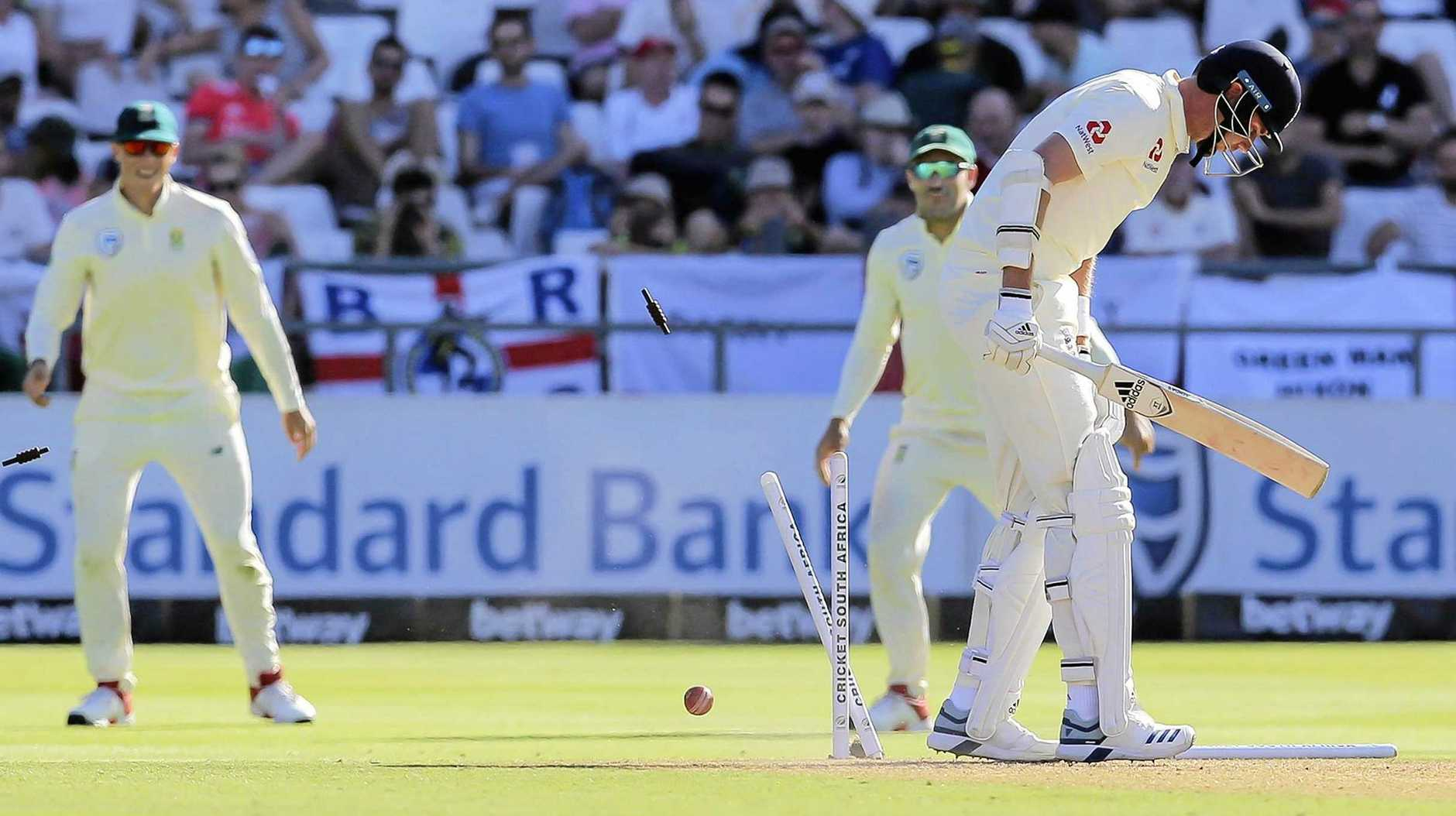 The stumps fly as England batsman Stuart Broad is bowled by South Africa's Kagiso Rabada on day one of the second Test in Cape Town. Picture: Halden Krog/AP