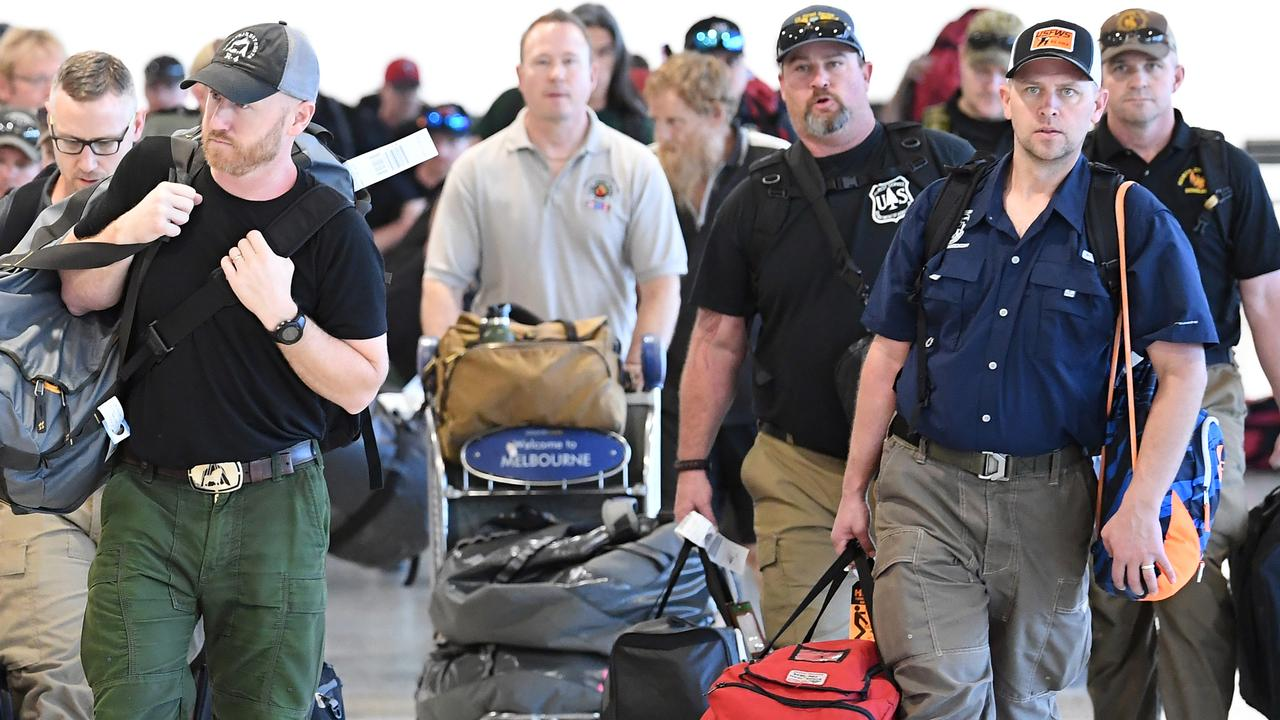 A contingent of 39 firefighters from North America arrive at Melbourne Airport on Thursday. Picture: AAP