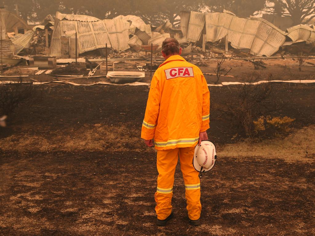CFA fire chief Steve Warrington at a destroyed house in Buchan. Picture: David Crosling