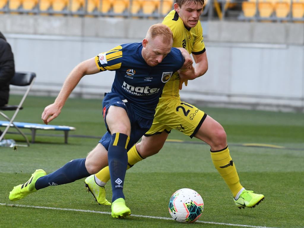 Mariners fullback Ziggy Gordon of the Mariners (front) and Callum McCowatt of the Phoenix contest the ball. Picture: AAP