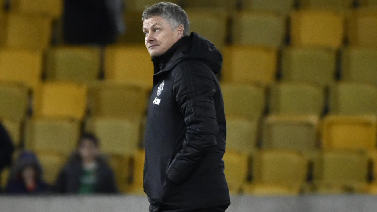 Manchester United's manager Ole Gunnar Solskjaer leaves the field at the end of the English FA Cup third round soccer match between Wolverhampton Wanderers and Manchester United at the Molineux Stadium in Wolverhampton, England, Saturday, Jan. 4, 2020. (AP Photo/Rui Vieira)