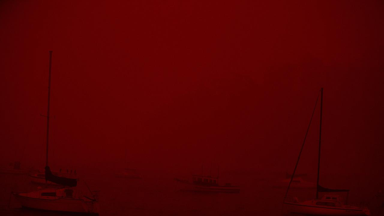 A dark and red glow has engulfed Eden. Picture: Gary Ramage/News Corp