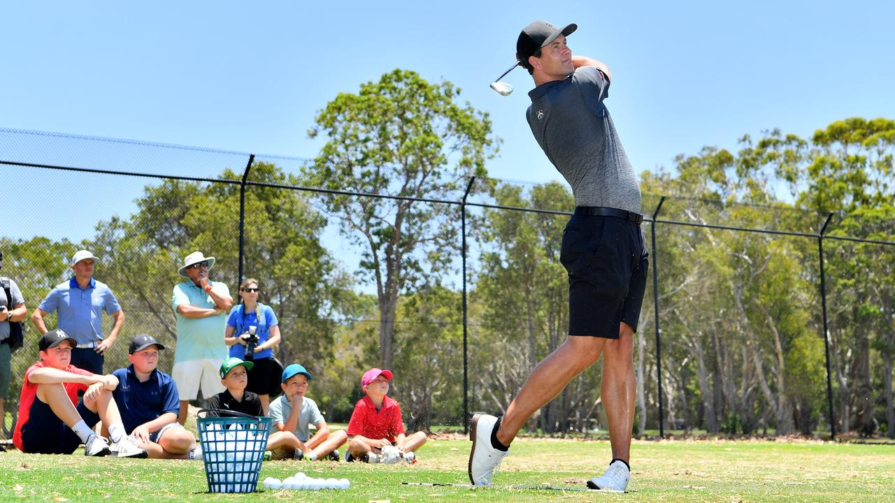 Professional golfer Adam Scott takes a swing during a juniors coaching clinic at Caloundra Golf Course on Saturday. Photo: John McCutcheon