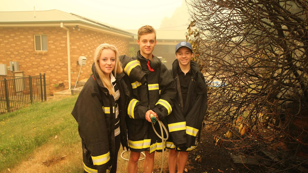 The Gould siblings stand at the point where the fire reached on Saturday night. Picture: Rohan Kelly