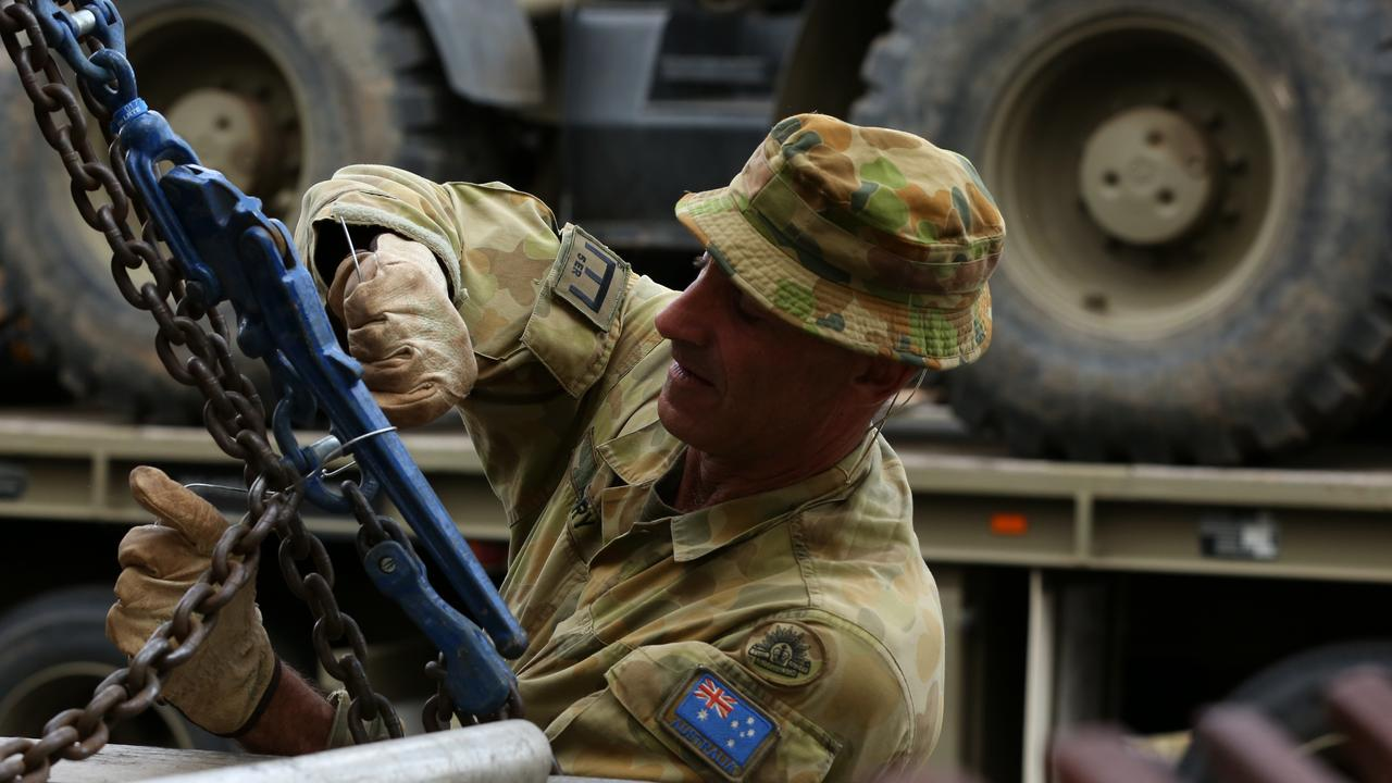 Corporal Justin Perry 4th Squadron 5ER fastens a vehicle to a truck at Holsworthy Barracks on Sunday. Picture: AAP/Danny Casey