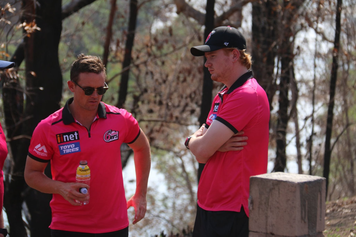 Sydney Sixers players Daniel Hughes and Lloyd Pope reflect on the tragic situation at fire ravaged Nymboida during a team visit ahead of their BBL09 fixture with Adelaide Strikers at C.Ex International Stadium in Coffs Harbour on Sunday, 5th January, 2019.
