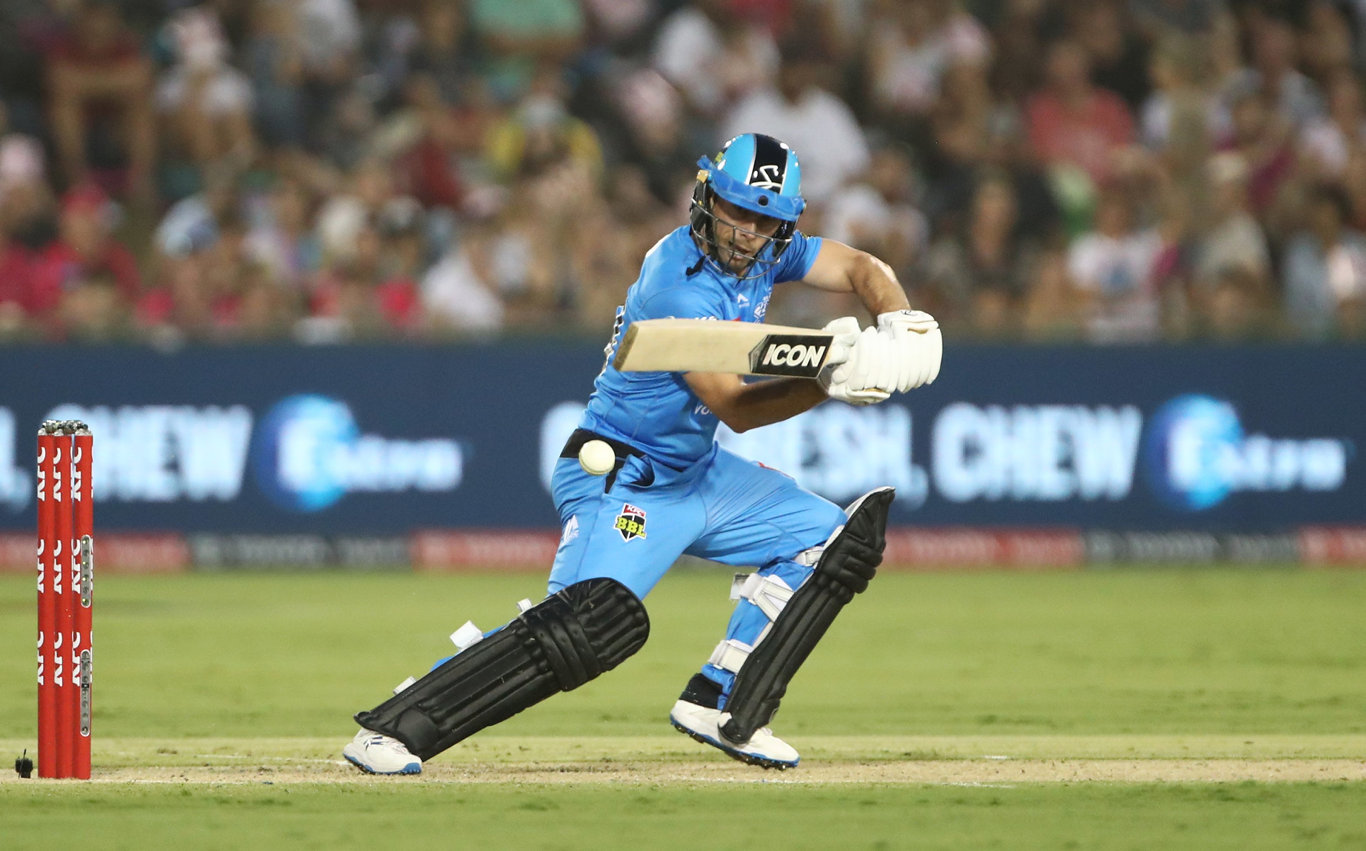 Jon Wells of the Strikers hits a boundary during his innings of 40 off 28 balls in the Big Bash League cricket match between the Sydney Sixers and Adelaide Strikers at Coffs International Stadium in Coffs Harbour, Sunday, January 5, 2020. Photo: Jason O'Brien / AAP