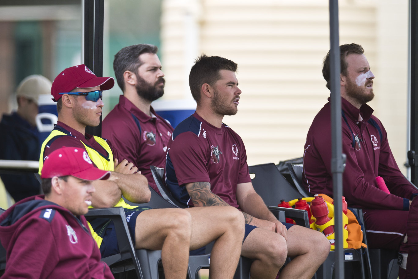 Queensland opener Mitchell English (front, centre) watches the game against Australian Capital Territory in Australian Country Cricket Championships round six at Middle Ridge Park, Monday, January 6, 2020. Picture: Kevin Farmer