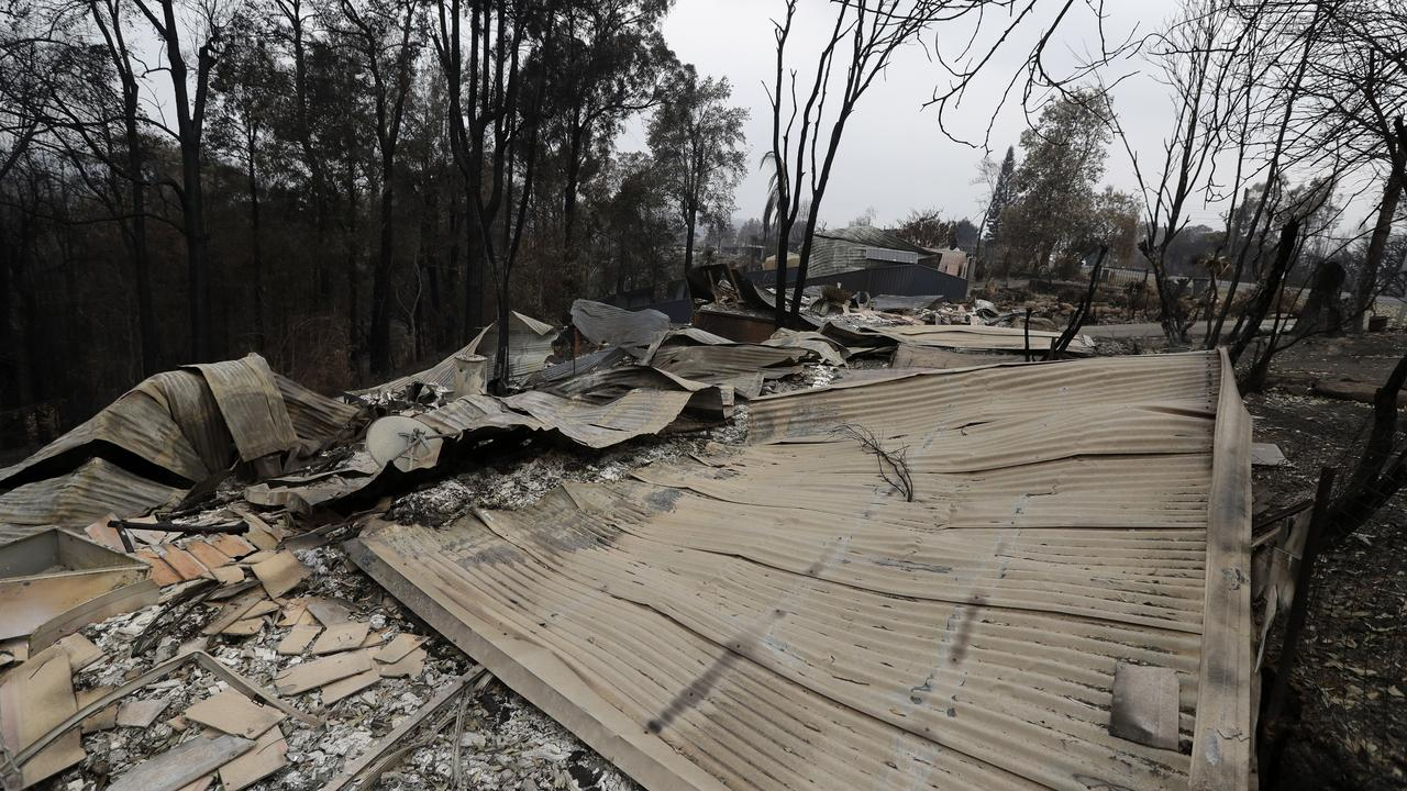 Houses are flattened at Conjola Park, Australia, after recent wildfires ravaged the community. Photo: Rick Rycroft/AAP
