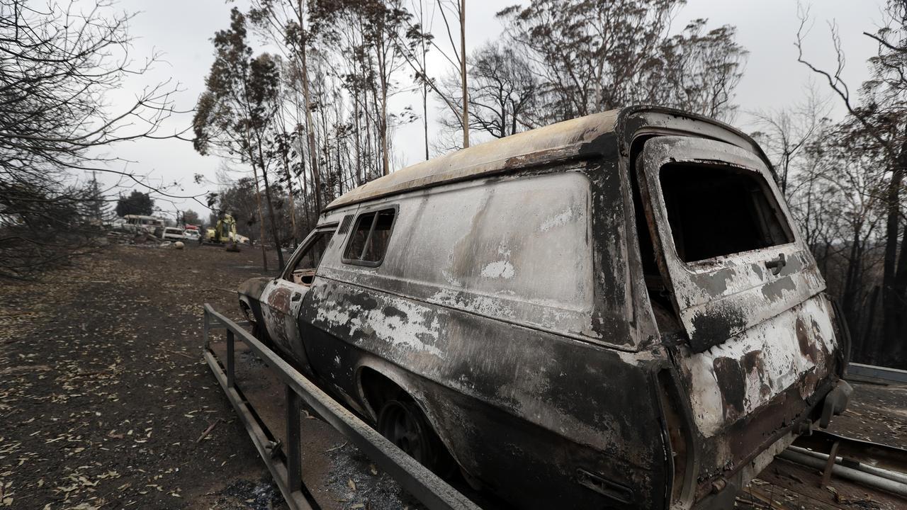 A car burnt out at Conjola Park, NSW. Photo: Rick Rycroft/AAP