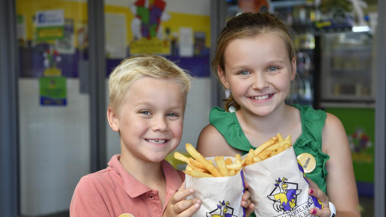 HELPING OUT: Hunter and Bridie Dowling hope others will support the firefighting effort by buying some large Crackerjack Chicken chips.  Picture: Kevin Farmer