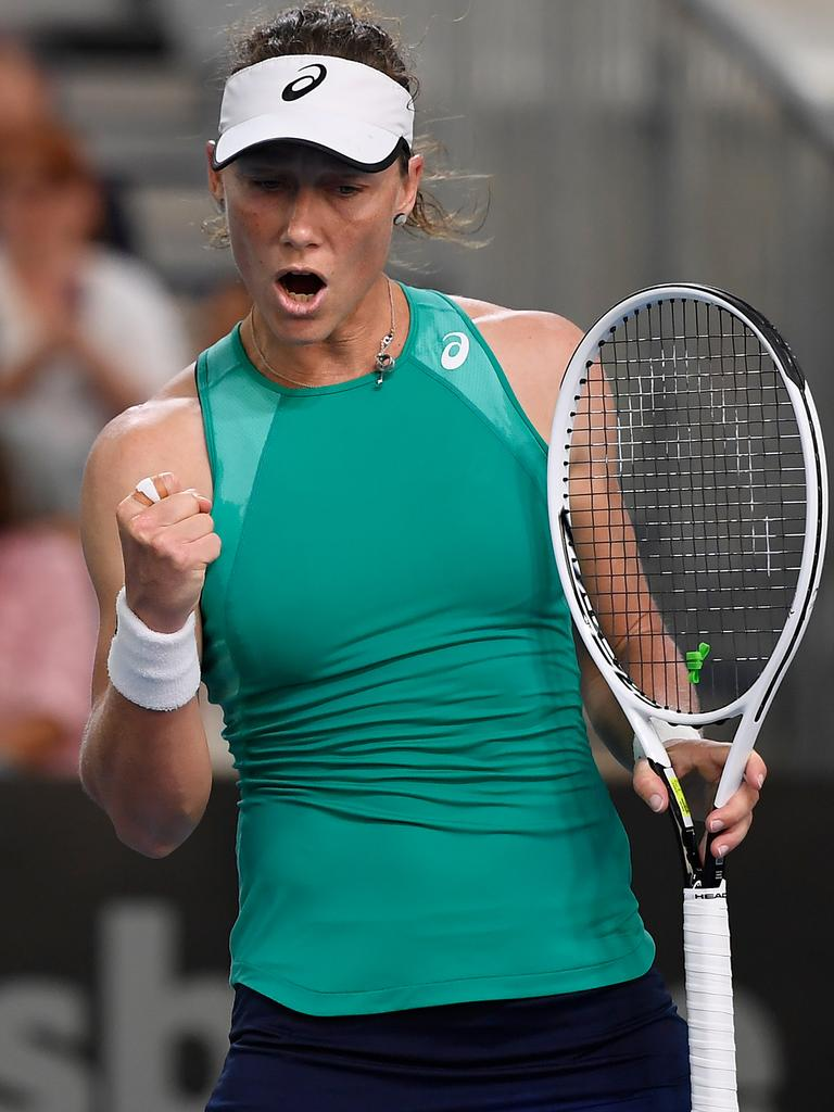 Stosur celebrates winning a point.