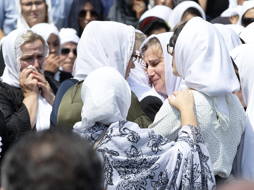 Women console each other at Lindita and Veton's funeral, which was attended by 1000 mourners. Picture: Sarah Matray
