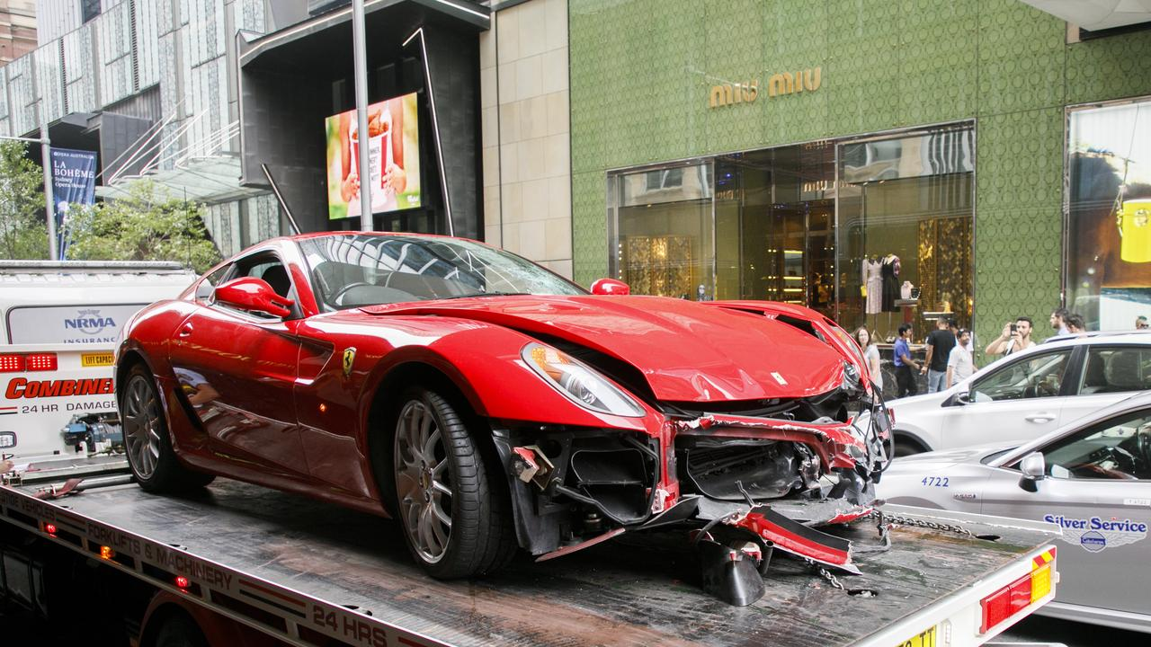A luxury Ferrari sports car has crashed into a luxury store.
