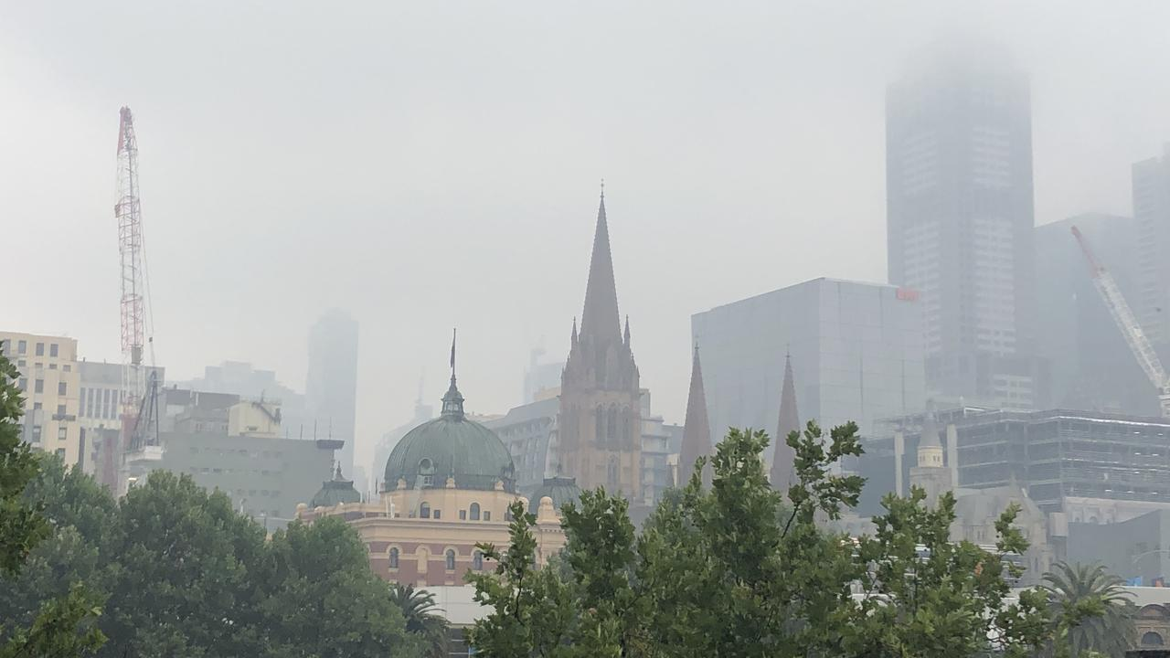 Smoke haze covers the top of Melbourne's skyscrapers.