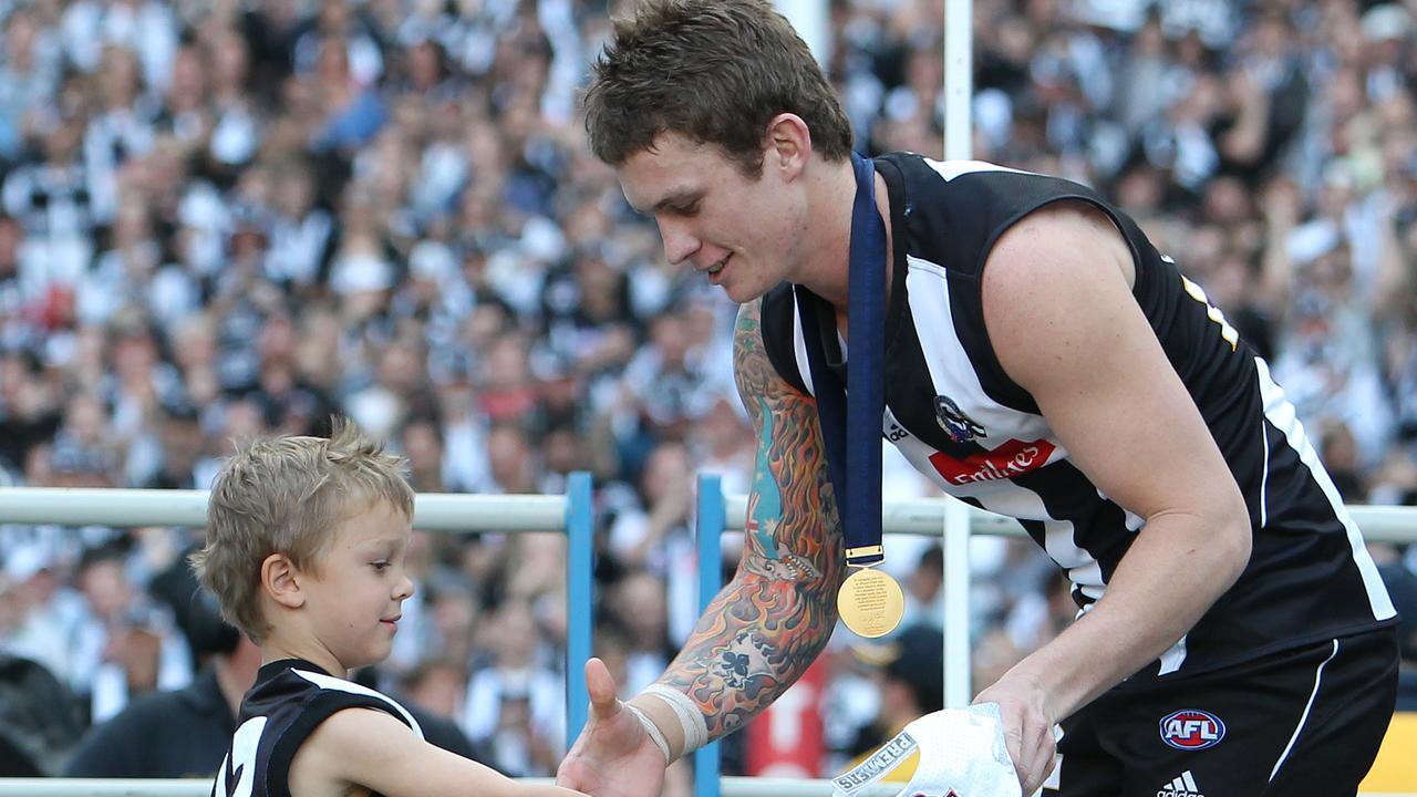 Dayne Beams receives his premiership medal after the 2010 grand final.